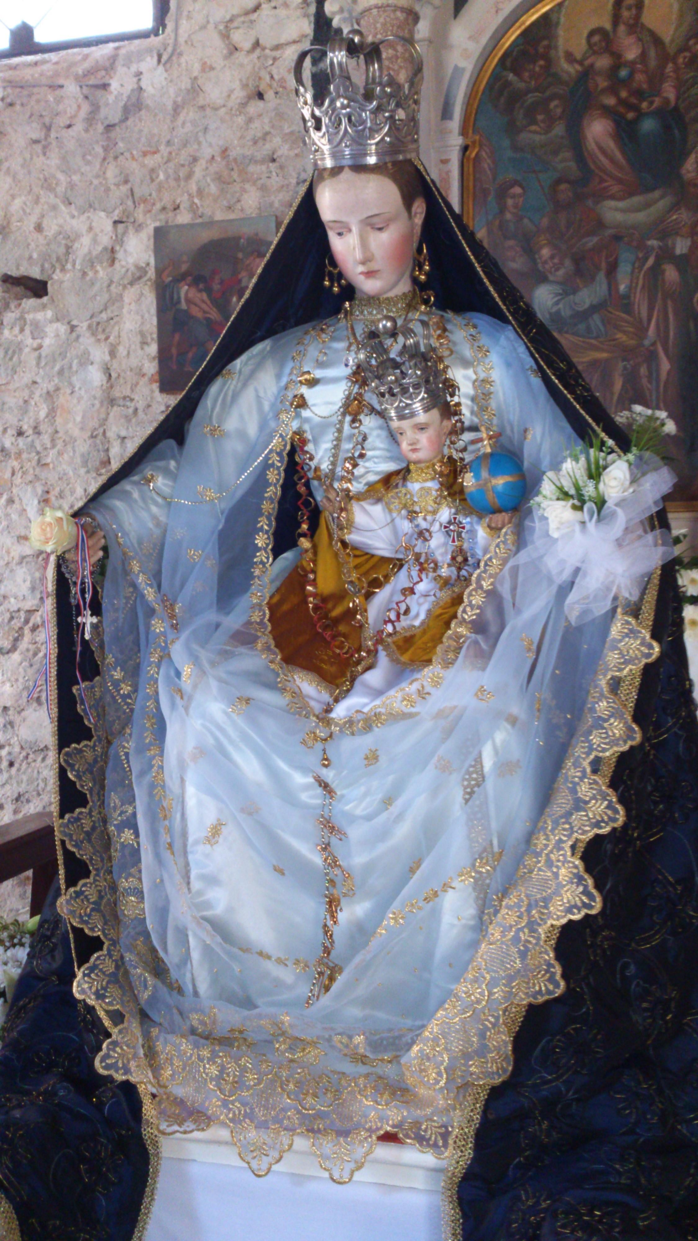 Veli Iž, Gospin kip (19. st., Tirol)